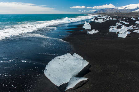 jokulsarlon: Beautiful beach in the South of Iceland with a black lava sand is full of icebergs from glaciers not far away Stock Photo