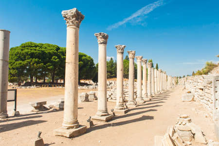 Row of Columns in the ruins of ancient Greek city of Ephesus photo