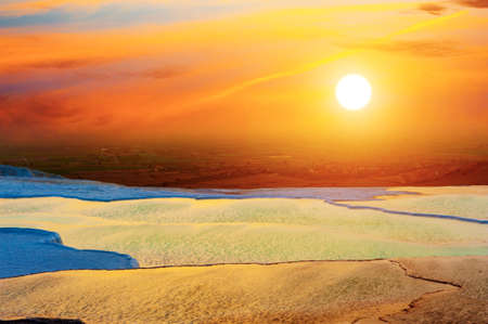 Beautiful vivid sunset over the travertine terraces and pools at Pamukkale, Turkey photo