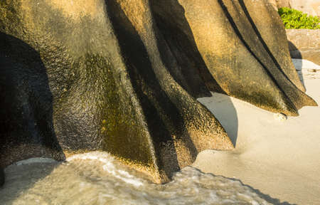 d argent: Beautifully shaped granite boulder in the sea of Seychelles at Anse Source dArgent