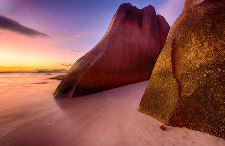 anse source d argent: Beautifully shaped granite boulders and a dramatic sunset  at Anse Source dArgent beach, La Digue island, Seychelles Stock Photo