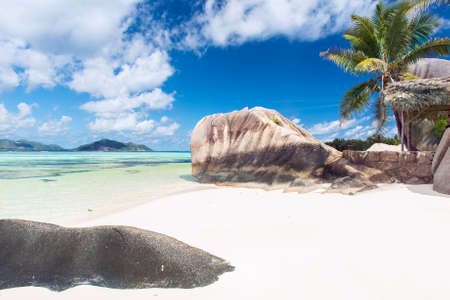 anse source d argent: Beautifully shaped granite boulders and a perfect white sand at Anse Source dArgent beach, La Digue island, Seychelles Stock Photo