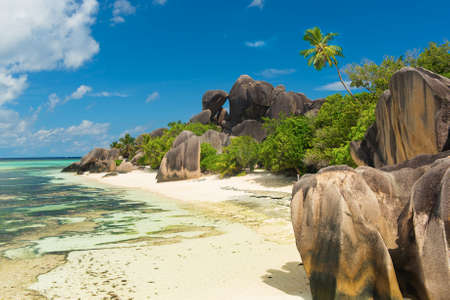 Beautifully shaped granite boulders and a perfect white sand at the famous Anse Source dArgent beach, La Digue island, Seychelles photo