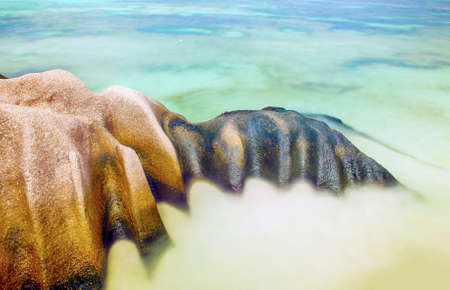 anse source d argent: Beautifully shaped granite boulder in the sea of Seychelles at Anse Source dArgent beach taken with a long exposure