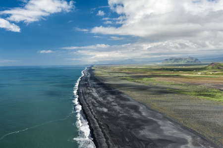 volcanism: Black sandy beach seen from the cliff at the cape Dyrholaey, the most southern point of Iceland.