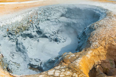 bubbling: Hot boiling mud at fumarole is bubbling and exploding at mudpots, Hverir - Icelnad. When photographed at high speed nice sculptures could be seen Stock Photo