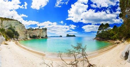 new zealand beach: Panoramic photo of a beautiful beach at Stingray Bay at Cathedral Cove Marine Reserve, Coromandel Peninsula, New Zealand. Stock Photo