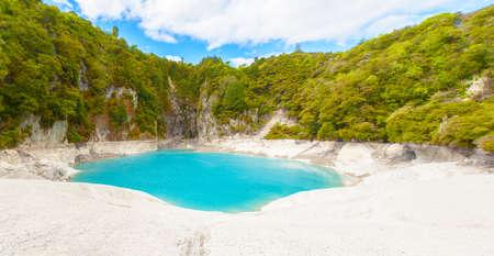 acidic: Incredibly blue and highly acidic Inferno Crater Lake at Waimangu geothermal area, New Zealand Stock Photo