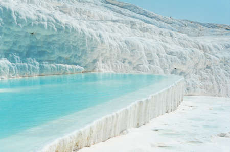 travertine: Blue pools and white travertine terraces at Pamukkale, Turkey