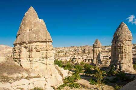 goreme: Fairy tale chimneys in Love Valley near Goreme, Cappadocia, Turkey Stock Photo