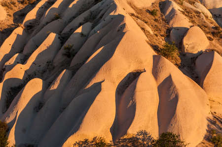 Detailed photo of vivid rock formations shaped by a morning light - seen from above in Cappadocia, Turkey photo