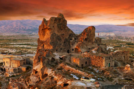 Uchisar castle at sunset, Cappadocia, Turkey photo