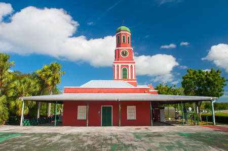garrison: Famous red clock tower on the main guardhouse at the Garrison Savannah. UNESCO garrison historic area Bridgetown Barbados