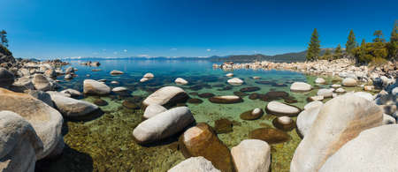 sand harbor: Beautiful boulders and crystal clear water of the lake Tahoe. Hidden Beach Lake Tahoe  Nevada USA. Panoramic photo Stock Photo