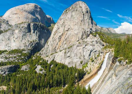 nevada: Beautiful Nevada Falls is located on Merced river and under mighty Liberty Dome grantite cap. Yosemite National Park California USA Stock Photo