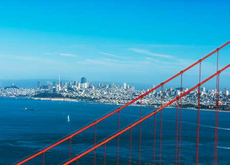 san francisco golden gate bridge: City of San Francisco seen through wires of the Golden Gate Bridge. California USA