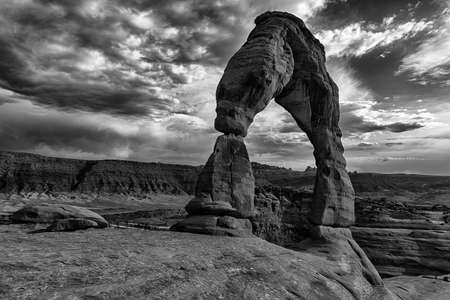 storm clouds: Late evening photo of a Delicate Arch with a dramatic stormy sky in the back. Arches National Park Utah  USA. Monochrome