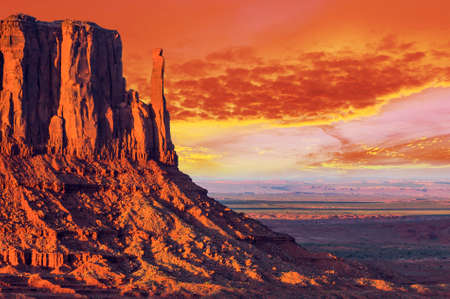 monument: Beautiful dramatic sunset over the West Mitten Butte in Monument Valley. Utah USA Stock Photo
