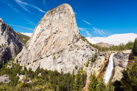 merced: Beautiful Nevada Falls is located on Merced river and under mighty Liberty Dome grantite cap. Yosemite National Park California USA Stock Photo