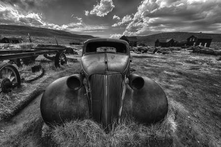 abandoned car: Wreck of a ancient rusty car in a ghost town of Bodie. Bodie is a National Historic Landmark. It is located in Mono County, Sierra Nevada - California. United States of America.
