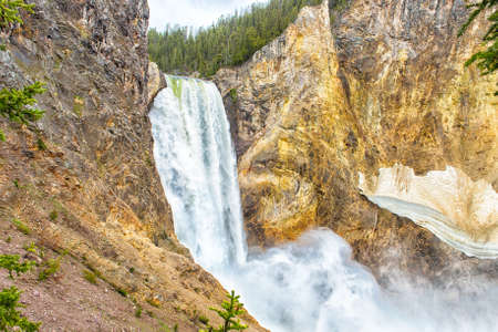 lower yellowstone falls: View at Lower Falls in Yellowstone Grand Canyon seen from uncle Toms trail. Yellowstone National Park, Wyoming, USA Stock Photo