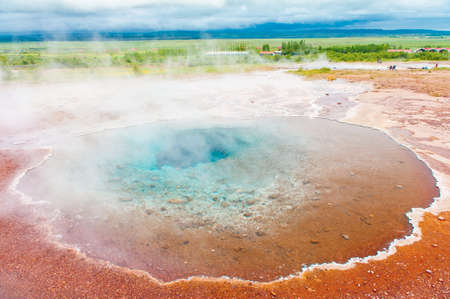 highland: Blue pool Blesi at Haukadalur geothermal field, Iceland