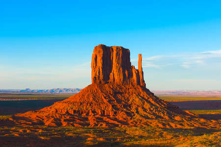 butte: Beautiful sunset over the West Mitten Butte in Monument Valley. Utah, USA