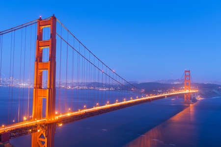 san francisco bay: Night view at illuminated Golden Gate Bridge which spans Golden Gate strait at San Francisco Bay. California, USA Stock Photo