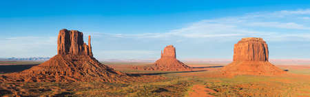 butte: Beautiful dramatic sunset over the Mittens Buttes and Merrick Butte in Monument Valley. Utah, USA. Panoramic photo