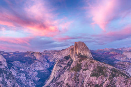 yosemite national park: Half Dome seen from the Glacier Point after the sunset. Yosemite National Park, USA Stock Photo
