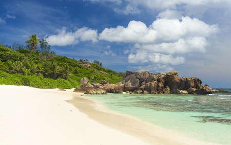 la: Beautifully shaped granite boulders and a perfect white sand at Grand Anse, La Digue island, Seychelles Stock Photo