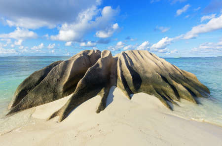 argent: Beautifully shaped granite boulders and a perfect white sand at Anse Source dArgent beach, La Digue island, Seychelles Stock Photo