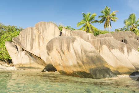 d'argent: Beautifully shaped granite boulders and a perfect white sand at the famous Anse Source dArgent beach, La Digue island, Seychelles