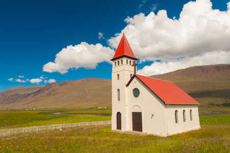 church building: Beautiful small Icelandic church in the rural area under the mighty fjords