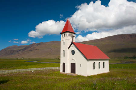 functionalism: Beautiful small Icelandic church in the rural area under the mighty fjords