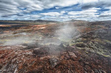 inhospitable: Inhospitable dramatic volcanic landscape full of steam at Krafla geothermal area, Iceland Stock Photo