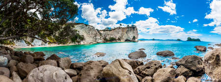 beach panorama: Panoramic photo of a beautiful beach at Stingray Bay at Cathedral Cove Marine Reserve, Coromandel Peninsula, New Zealand. Stock Photo