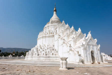 bank western: Shrine on the top of beautiful white Hsinbyume Pagoda in Mingun, Western bank of Irrawaddy river, Myanmar