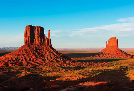 butte: Beautiful sunset over the West and East Mitten Butte in Monument Valley. Utah, USA Stock Photo