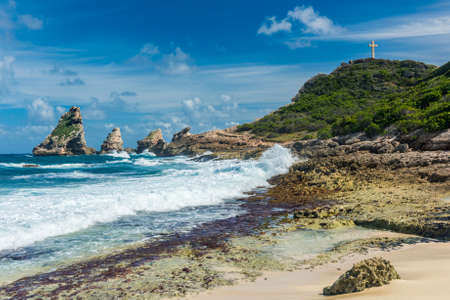 guadeloupe: Rocks and hills  of Pointe des Chateaux, the most Eastern point of French island  of Guadeloupein the Caribbean Stock Photo