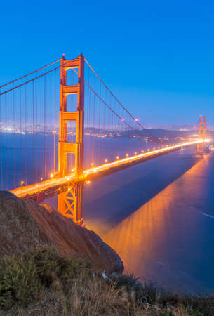 city road: Night view at illuminated Golden Gate Bridge which spans Golden Gate strait at San Francisco Bay. California, USA Stock Photo