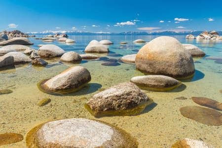 lake beach: Beautiful boulders and crystal clear water of the lake Tahoe. Hidden Beach, Lake Tahoe - Nevada, USA