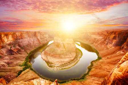 page arizona: Vivid dramatic sunset over Horseshoe Bend, a famous meander on river Colorado near the town of Page. Arizona, USA