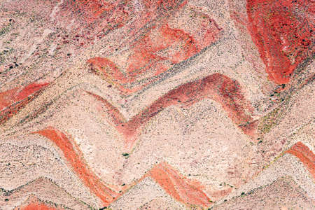 strata: Interesting background of red banded strata viewed from Highway 163. The zigzag pattern is result of erosion of the tilted strata. Mexican Hat, Utah - USA Stock Photo