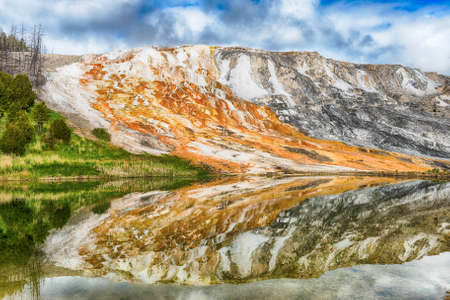 formations: Anglel Terrace reflecting in water in Upper Terrace Area. Mammoth Hot Springs, Yellowstone National Park - Wyoming, USA