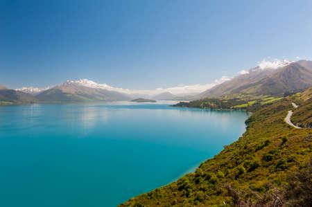 wakatipu: Beautiful blue lake Wakatipu with mighty Southern Alps mountains on horizon. Otago region, New Zealand. Stock Photo