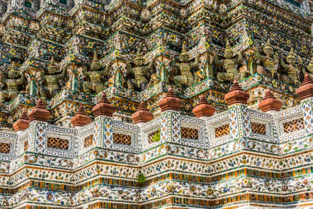 wat arun: Detail of the temple of Wat Arun with statues of demon guardians. Bangkok, Thailand Stock Photo