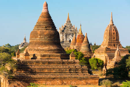 Late afternoon sun shines on old pagodas of an ancient city of Bagan, Myanmar