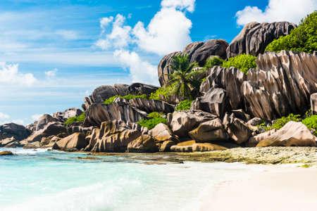 la digue: Beautifully shaped granite boulders and a perfect white sand at Grand Anse, La Digue island, Seychelles Stock Photo