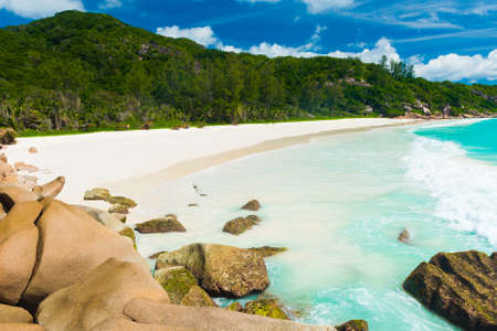 Beautiful and a famous beach Anse Petite seen from the granite boulders, La Digue island, Seychelles.